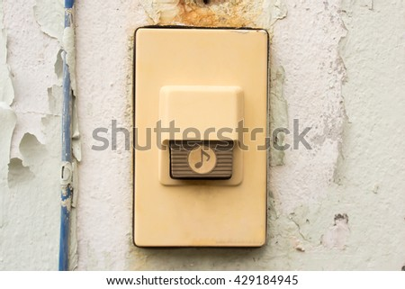 Old and dirty doorbell on concrete wall background, vintage effect - stock photo