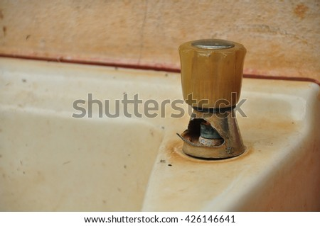 Old and dirty faucet - stock photo