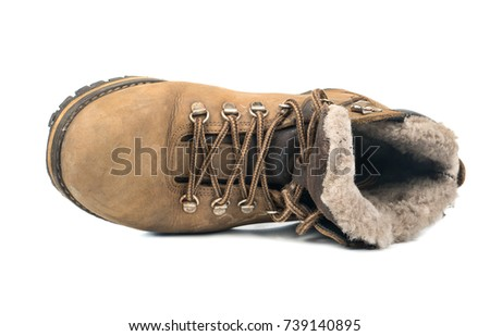 Old and dirty mens winter boots on white background