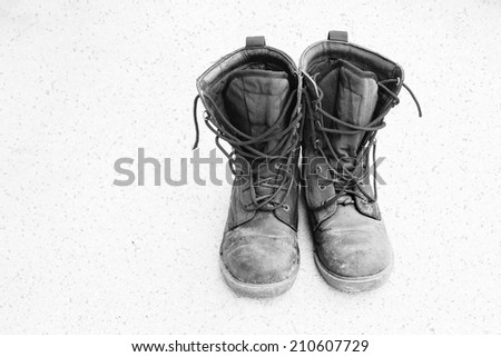 Old and dirty military boots - stock photo