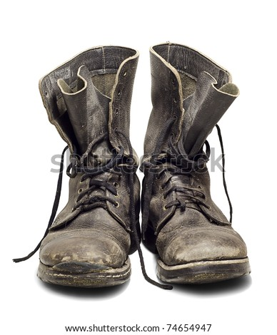 Old and dirty military boots isolated on white background - stock photo