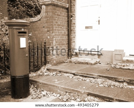 Old and dirty post box among the house scene.