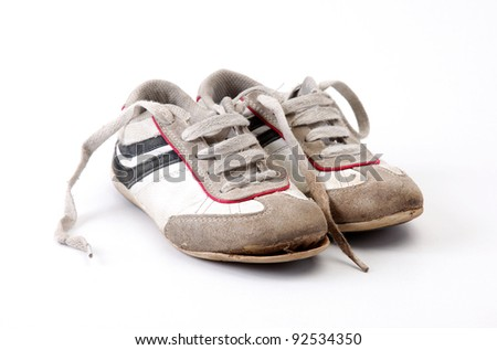 Old and dirty tennis on white background - stock photo