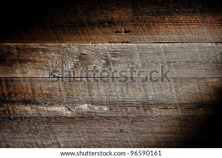 Old and distressed antique grey board made of rough sawn barn wood plank with vintage weathered textured grain grunge background - stock photo