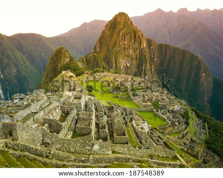 Old and famous inca's city ruins in the morning sunrise (Peru) - stock photo