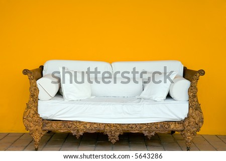 old and grunge iron sofa with white cushion - stock photo