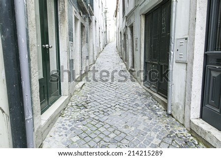 Old and historic alley in Lisbon, detail of an old street in the historical district, tourism in Portugal - stock photo