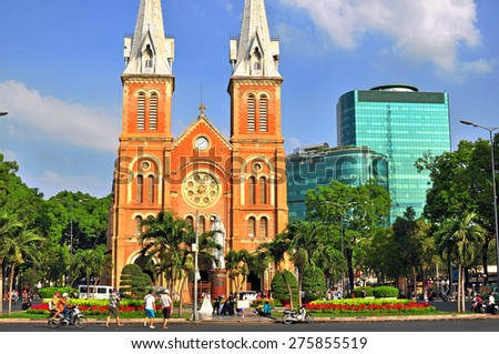 Old and modern architecture on the Cathedral square of Saigon, Vietnam - stock photo