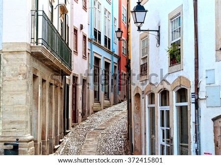 Old and narrow street of Coimbra city in Portugal - stock photo