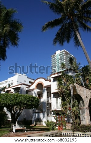 Old and New Buildings in Mexico Resort - stock photo