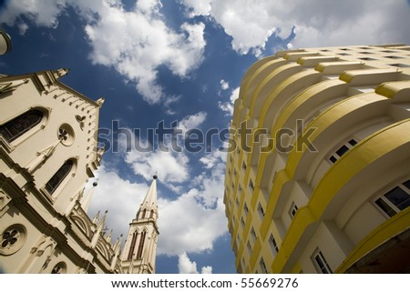 Old and new buildings in the city of Curitiba, Brazil. - stock photo