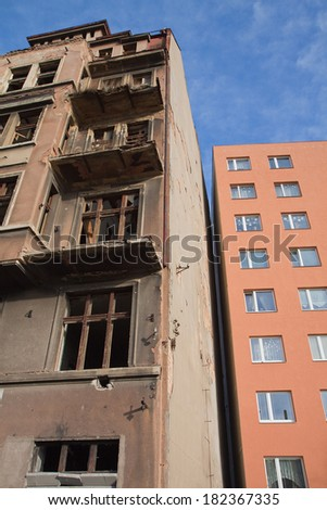Old and new buildings next to each other, Teplice , Czech Republic  - stock photo