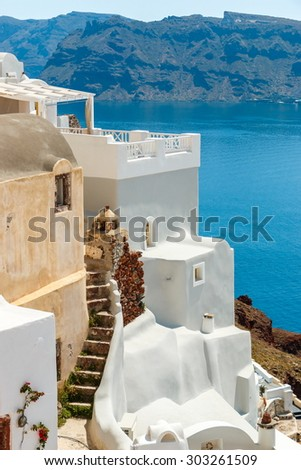 Old and new house near the sea in Oia town, Santorini island - stock photo