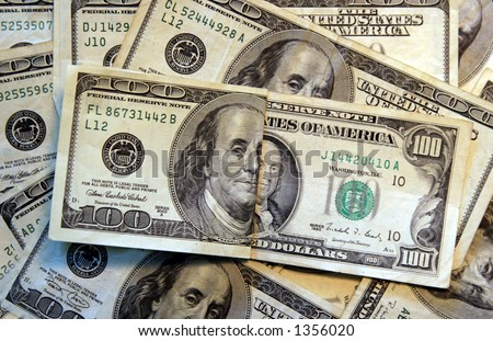 Old and new hundred dollar bills. - stock photo