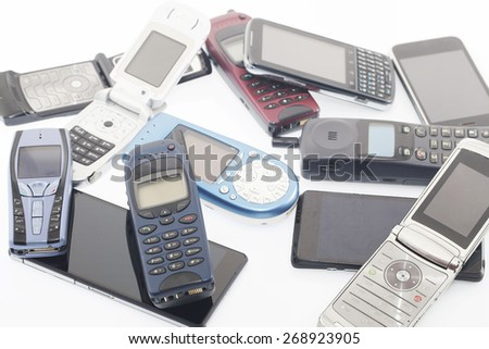 Old and new Mobile phones, smartphone - stock photo