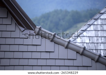 Old and new roof - stock photo