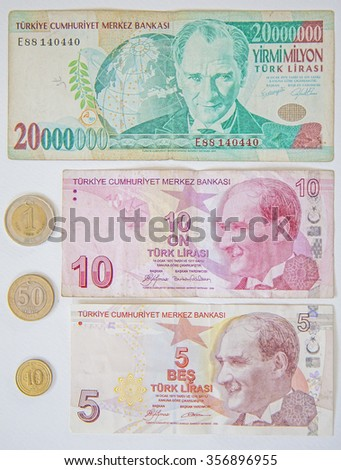 Old and new Turkish money in different banknotes and coins. - stock photo