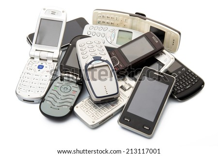 old and obsolete cellphone on white background - stock photo