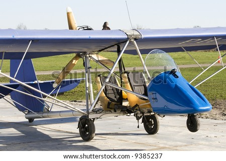 old and open ultra light plane - stock photo