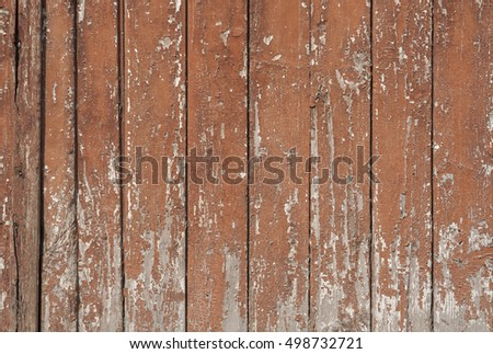 Old and peeling paint on wood.
