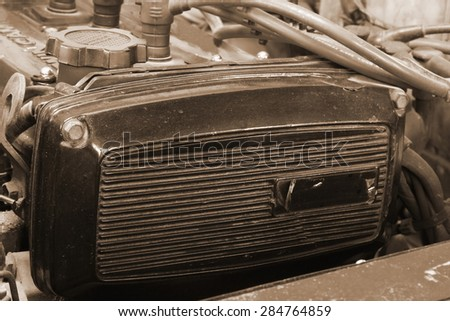 Old and retro style of Japanese car engine on sepia tone represent the car part concept related idea. - stock photo