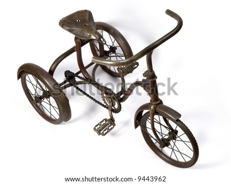 Old and rust iron tricycle. - stock photo