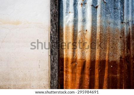 Old and Rusted decay metalsheet wall with wood fram and cement wal - stock photo
