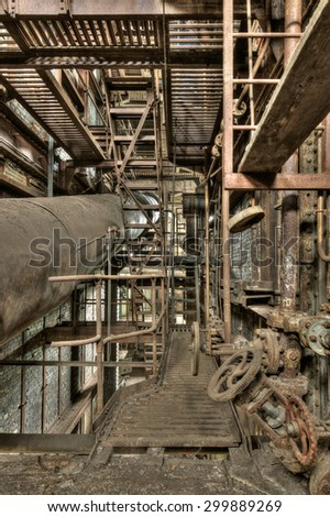 Old and rusted elements in an abandoned power plant, HDR processing - stock photo