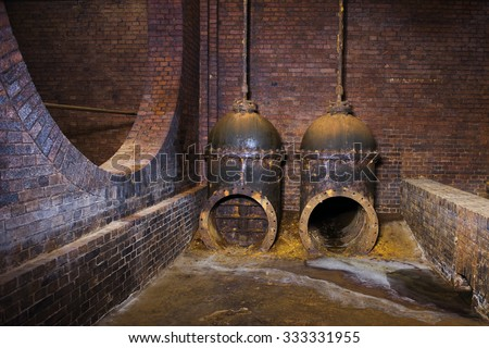 old and rusted pipe fittings - stock photo