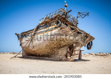 old and rusty desolate fishing ship in shipyard - stock photo