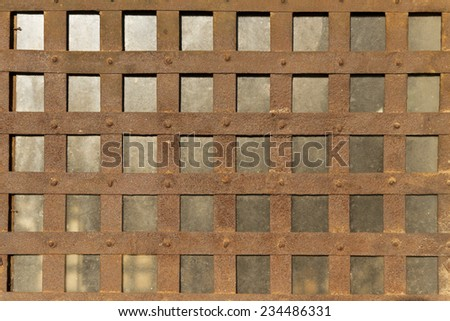 Old and rusty metal grid. - stock photo