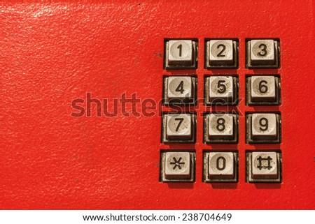 old and rusty telephone keypad - stock photo