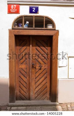 old and shabby door way - stock photo