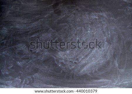 Old and used blackboard dirty school white chalk dust - stock photo