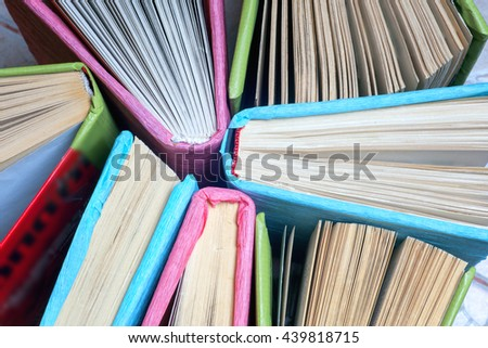 Old and used colorful hardback books or text books seen from above. Back to school. - stock photo