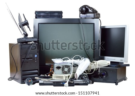 Old and used electric home waste. Obsolete pc computer, telephone, CRT monitor, DVD. - stock photo