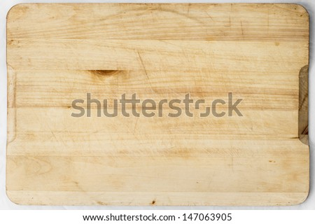 Old and used natural wooden cooking board with cuts - stock photo