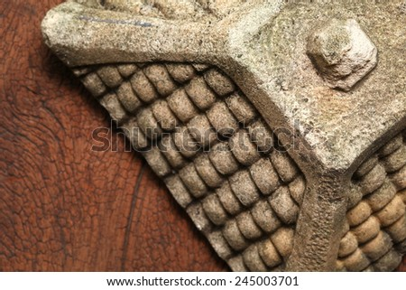 Old and vintage surface texture of sand stone pavilion roof architectural sculpture model with moss stain represent the texture and surface background. - stock photo