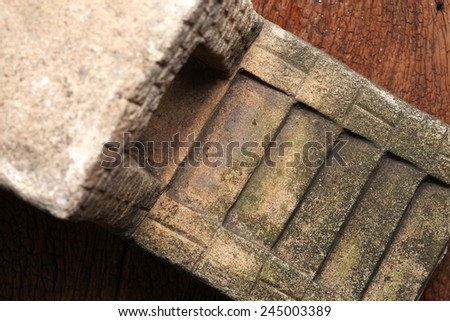 Old and vintage surface texture of sand stone pavilion stair architectural sculpture model with moss stain represent the texture and surface background.