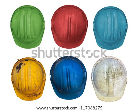 Old and worn colorful construction helmets isolated on white - stock photo
