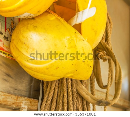 Old and worn colorful construction helmets on background. - stock photo