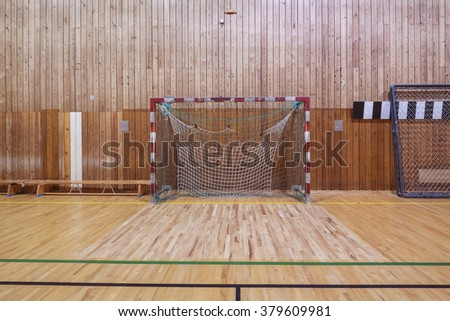 Old and worn indoor soccer gymhall - stock photo