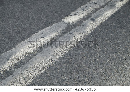 old and worn markings on asphalt - stock photo