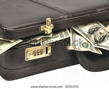 Old and worn non-descript briefcase overflowing with US currency