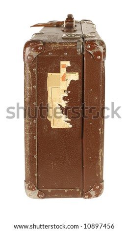 Old and worn retro suitcase isolated on white background - side view - stock photo