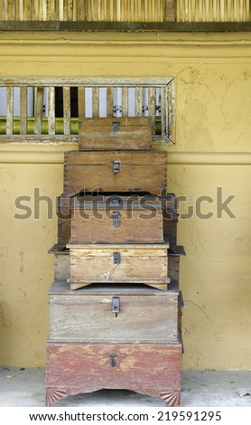 old and worn tatty traditional antique wooden chest grungy looking - stock photo