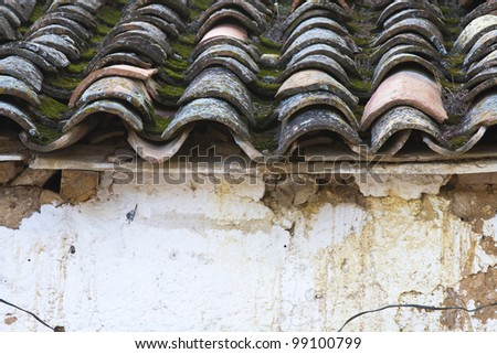 old and worn tiles on typical Spanish house - stock photo