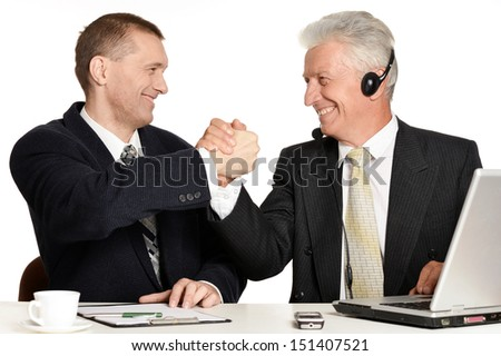 Old and young businessmen made a deal - stock photo