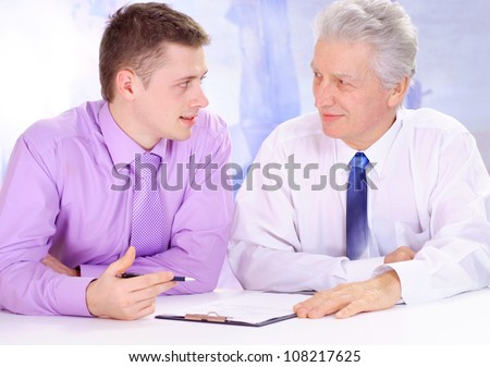 Old and young guy, working in very different fields of activity - stock photo