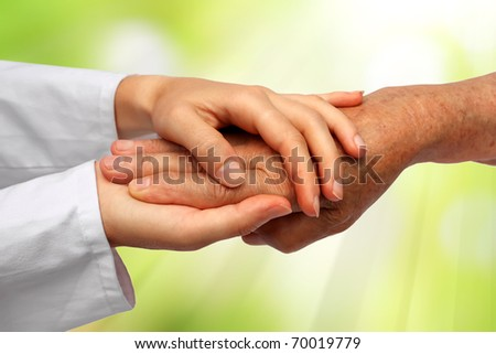 Old and young hand - stock photo
